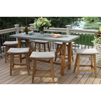 Outdoor Interiors 7 piece Teak & Wicker Counter Height Dining Set with Grey Composite Top & Saddle Stools  by Outdoor Interiors